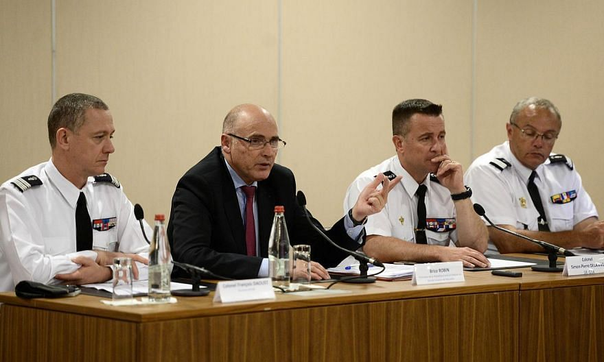 French prosecutor of Marseille Brice Robin (centre) speaking as French Colonel Francois Daoust (left), head of the criminal research Institute of the French Gendarmerie, and Colonel Simon-Pierre Delannoy (second, right), head of the research section