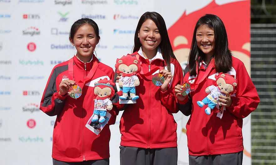 (From left) Shooters Jasmine Ser, Cheng Jian Huan and Li Yafei after winning a bronze in the women's 50m rifle prone team event on June 10, 2015. The trio also won bronze in the women's 50m rifle three-positions event on June 12. -- ST PHOTO: ONG WEE