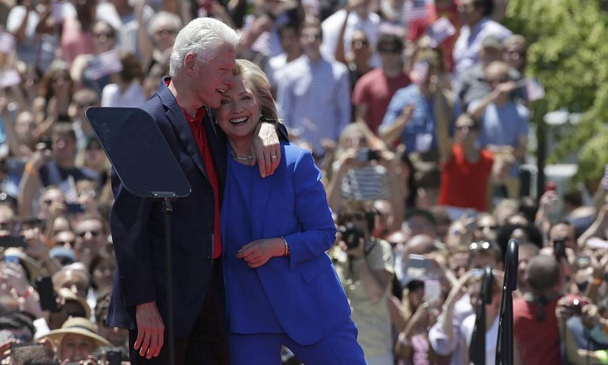 """US Democratic presidential candidate Hillary Clinton is embraced by her husband, former president Bill Clinton, after she delivered her """"official launch speech"""" at a campaign kick-off rally in Franklin D. Roosevelt Four Freedoms Park on Roosevelt Isl"""