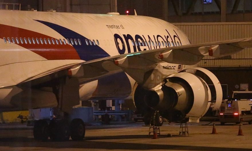 Malaysian Airlines aircraft flight MH148 sits on the tarmac at Melbourne Tullamarine Airport, Melbourne, Australia on June 12, 2015. -- PHOTO: EPA