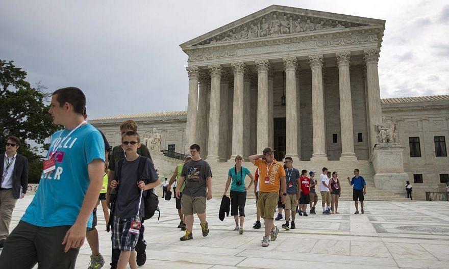Tour groups visit the Supreme Court in Washington, DC on Monday. -- PHOTO: EPA