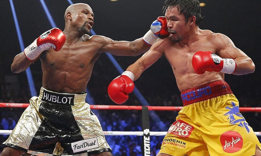 """Floyd Mayweather (left) and Manny Pacquiao easily """"knocked out"""" other contenders to top Forbes' 2015 list of the world's highest-paid celebrities with the reward from their mega fight. Musicians and athletes dominated the top 10 spots which had room"""