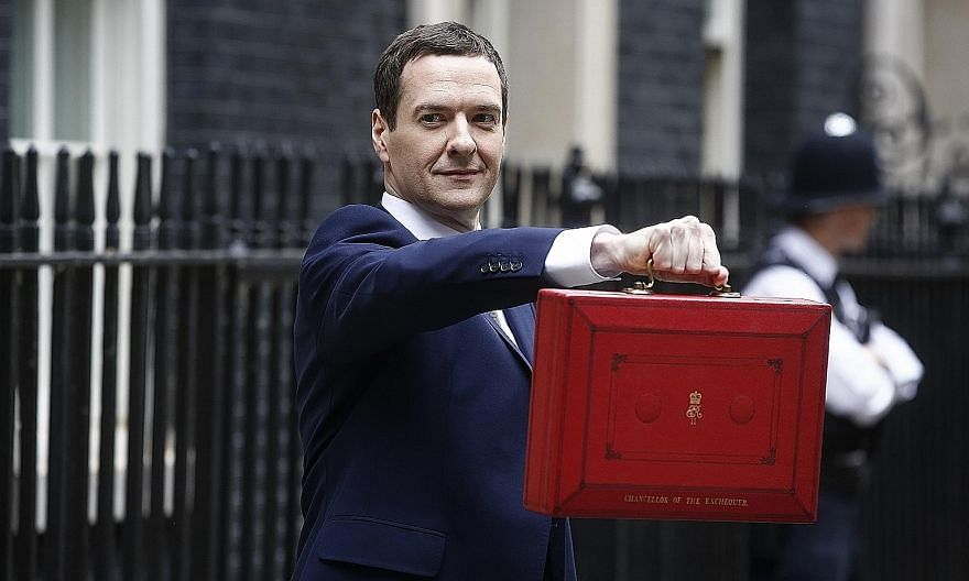 Mr George Osborne outside his official residence at 11 Downing Street holding the dispatch box containing his seventh Budget - but the first by a solely Conservative government in almost two decades.