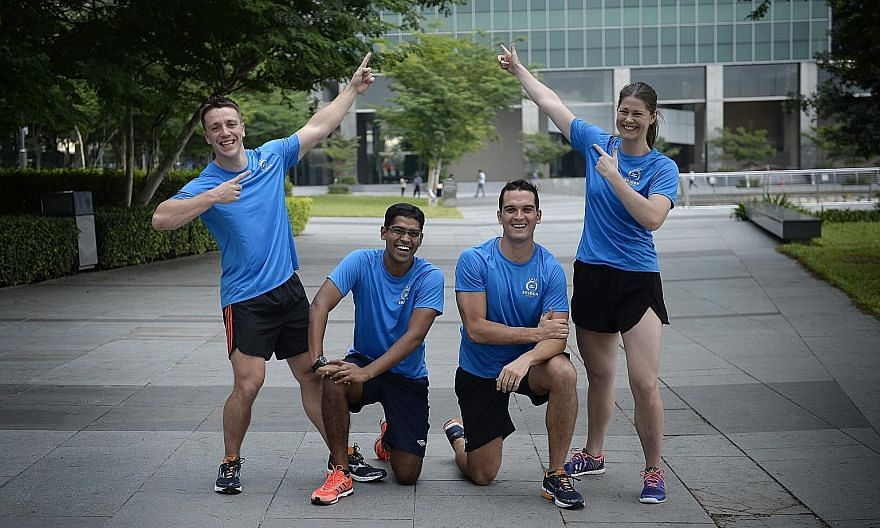 (From left) Sam Brennan, 29; Seishen Gerard, 28; Declan Halpin; 29; and Katherine Macfarlane, 27, the four physiotherapists who are undertaking the Mizuno Ekiden, at The Promontory@ Marina Bay. They will each run 5.3km.