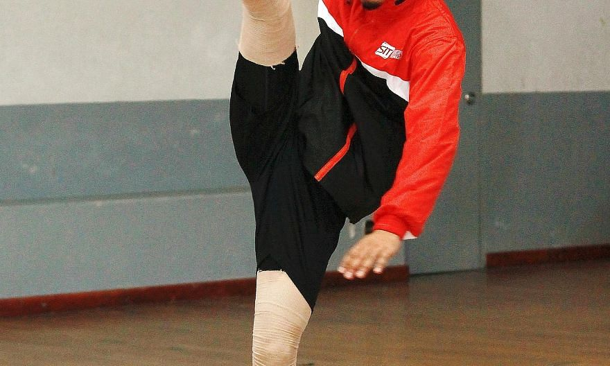 National sepak takraw player Mohmed Elhazeeq Ul Haq playing the role of the tekong, or server. The sport has such a following here and in Asia that finding teammates would not be too difficult.