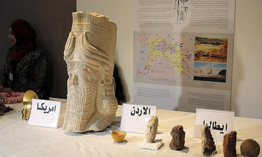 Recovered artefacts on display at the National Museum of Iraq in Baghdad. They include historical pieces ranging from an ancient Assyrian statue (above) to a 20th-century presidential tea set, jewellery and leather scripts (below).