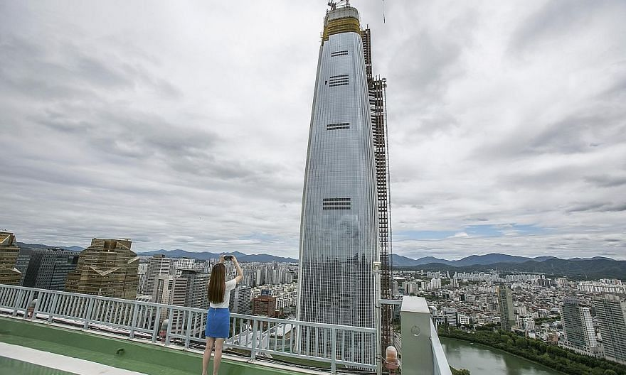 Measuring 555m tall, the Lotte World Tower (left) is expected to be the tallest building on the Korean Peninsula when it is completed.
