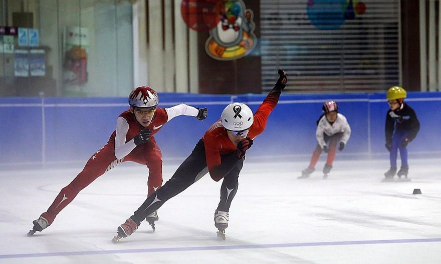Short-track speed skaters Lucas Ng (in black suit bottoms) and Matthew Mak in action. The pair hope to compete at the 2017 SEA Games.