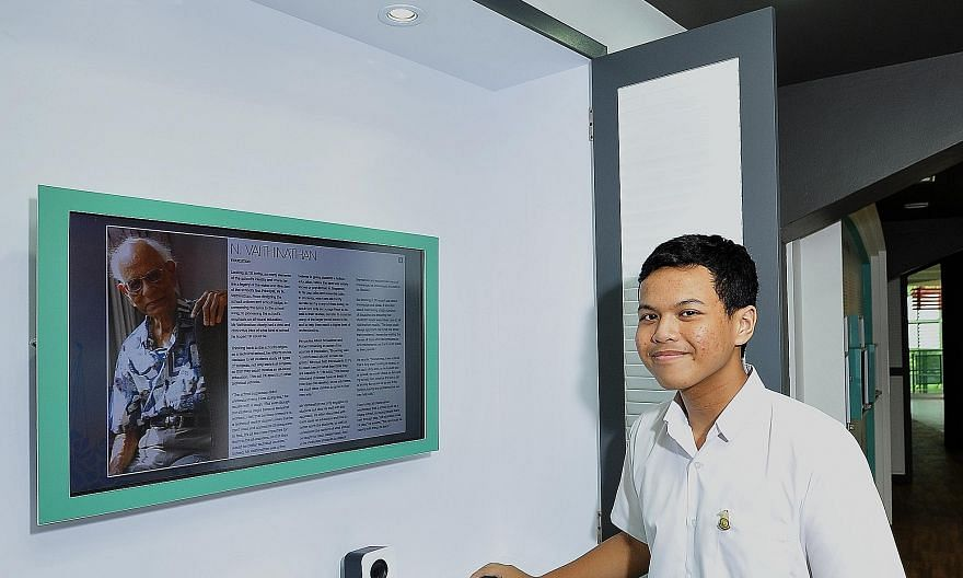 Student Haikal Afiq (above) is trained to conduct tours for the school's heritage gallery, which has displays such as information on past principals.