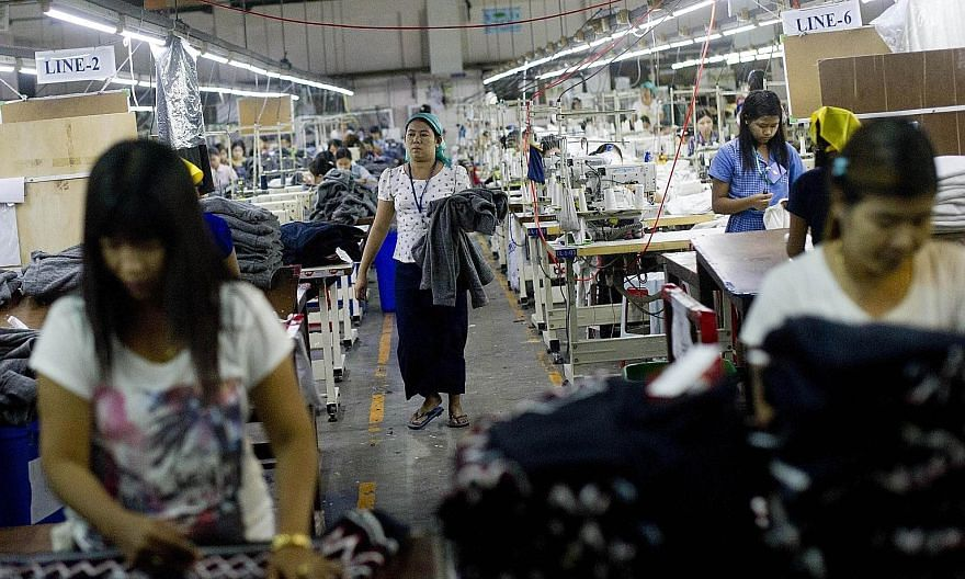 Employees at a garment factory in Yangon. Myanmar's economy is only just emerging from decades of relative isolation, and diving into regional and global integration is a daunting prospect. The business sector is heavily laced with protectionist sent