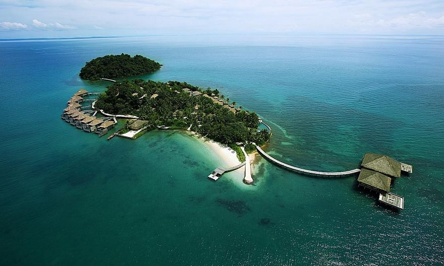 Cambodia's Song Saa Private Island (above) spans two islands in the Koh Rong Archipelago.