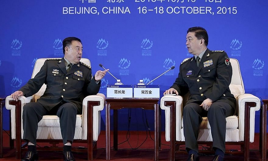 China's Central Military Commission vice-chairman Fan Changlong (left) speaking to Chinese Defence Minister Chang Wanquan at the Xiangshan Forum in Beijing last Saturday. The forum drew around 500 participants from some 60 countries, including 14 def