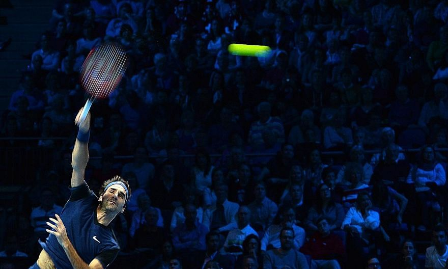 Roger Federer on his way to a 7-5, 6-2 win against world No. 1 Novak Djokovic in the ATP World Tour Finals in London on Tuesday.