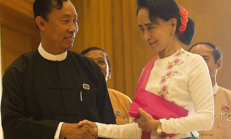 Ms Aung San Suu Kyi (right) yesterday held a closed-door meeting with Myanmar's parliamentary Speaker Shwe Mann (left) with whom she has developed an amicable working relationship.