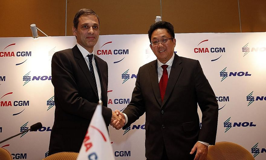 """Containers (right) aboard the CMA CGM Bougainville ship in the port of Le Havre, France. Mr Saade said CMA CGM will establish its regional head office in Singapore and use the country as a key hub in Asia, noting that """"Singapore and the region are ve"""