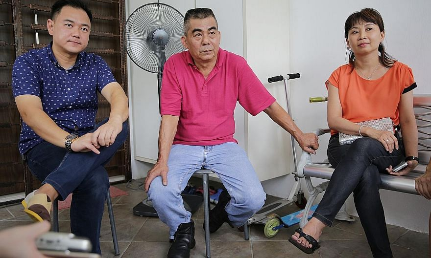 Left: Mechanic Chai Siew Fong (centre) reveals how his boss Tan Boon Sin paid him his salary for six months when he was caring for his wife. With him are Mr Tan's younger son, Chee Wee, and another of Mr Tan's employees, Ms Tan Hwee Eng. Above: Also