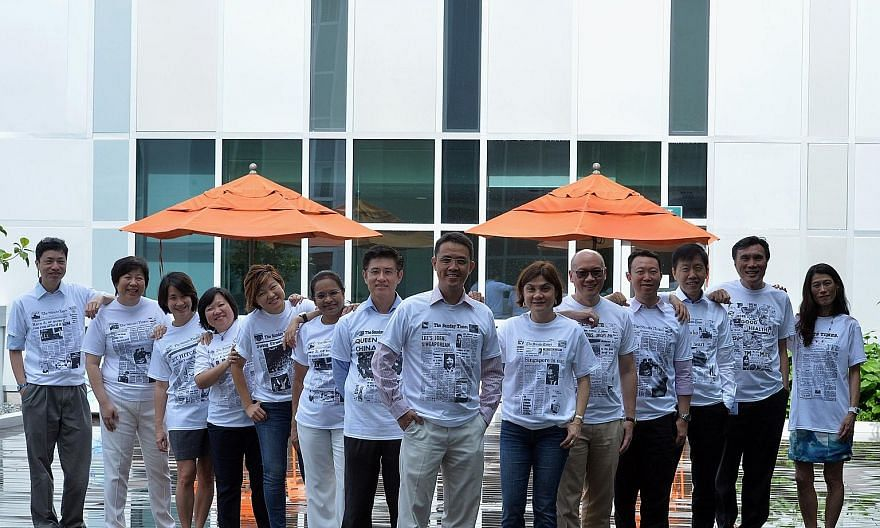 JurongHealth Services CEO Foo Hee Jug (eighth from left) with some of the recipients of The Straits Times 170th anniversary T-shirts, including JurongHealth medical board chairman Cheah Wei Keat (seventh from left) and Dr Thomas Soo (second from righ