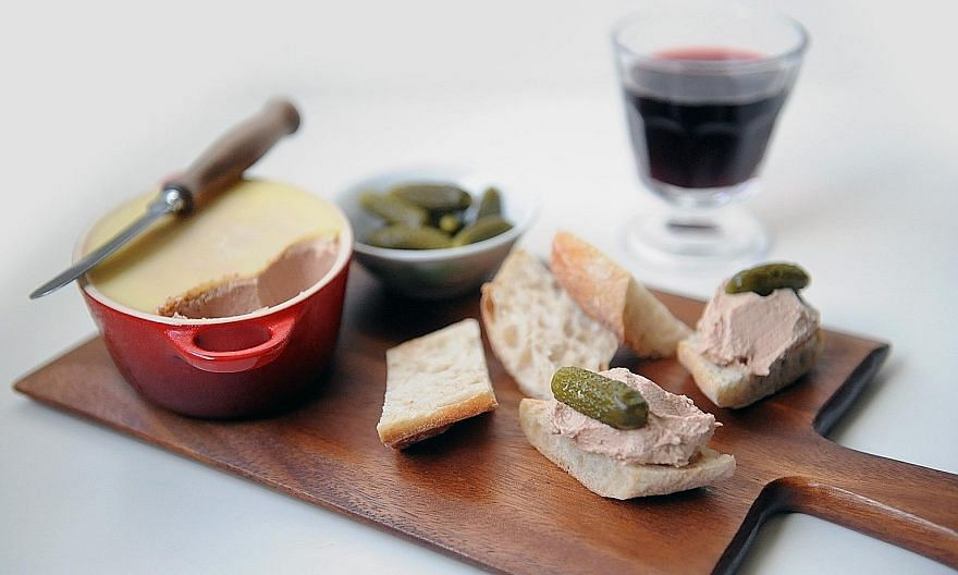 Chicken liver pate, tart cornichons and a warm baguette make a delicious snack.