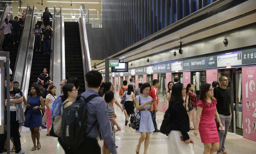 A light morning peak hour crowd using the Bukit Panjang Downtown Line station during its operation on the first weekday of Dec 27, 2015, since its opening over the weekend.