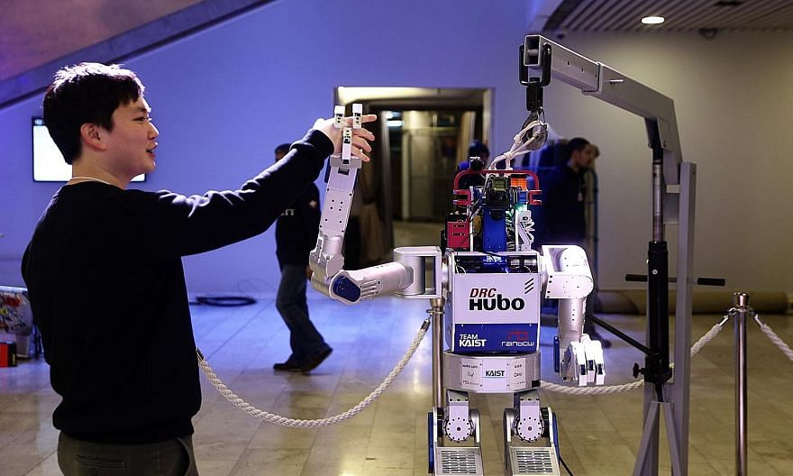 A South Korean robot called Hubo, seen here showing its dexterity at the World Economic Forum held in Davos, Switzerland, from Jan 20 to 23, is proof of new technologies coming rapidly on stream.