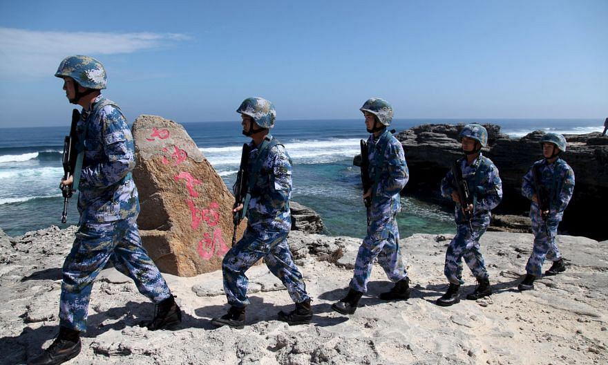 China's soldiers on Woody Island in the Paracel archipelago - which the Chinese call the Xisha islands - last month. Beijing's reported deployment last week of a surface-to- air-missile system to the Paracel islands coincided with the conclusion of a summ