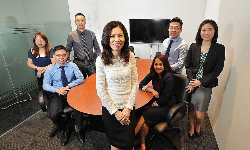 The team from KYC Group - (from left) accounts supervisor Ang Swee Hoon, senior auditor Kam Mau Thai, auditor Zheng Xu Tao, founder Vivienne Chiang, assistant accounts manager Ashley Tan, associate consultant Nicholas Ngai and audit manager Fatima Di