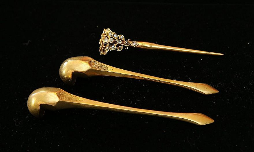 (Left) A kerosang centrepiece with a deer motif that is estimated to have been made in the late 1800s. (Left below) These earrings are estimated to be made around the mid-1900s from 20K gold with rose-cut diamonds. A hairpin set which belonged to Mr