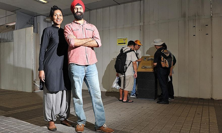 Mr Singh and Ms Vithya near the site of the now-defunct Outram Prison on a trail featured in the Sikh Heritage Trail app.