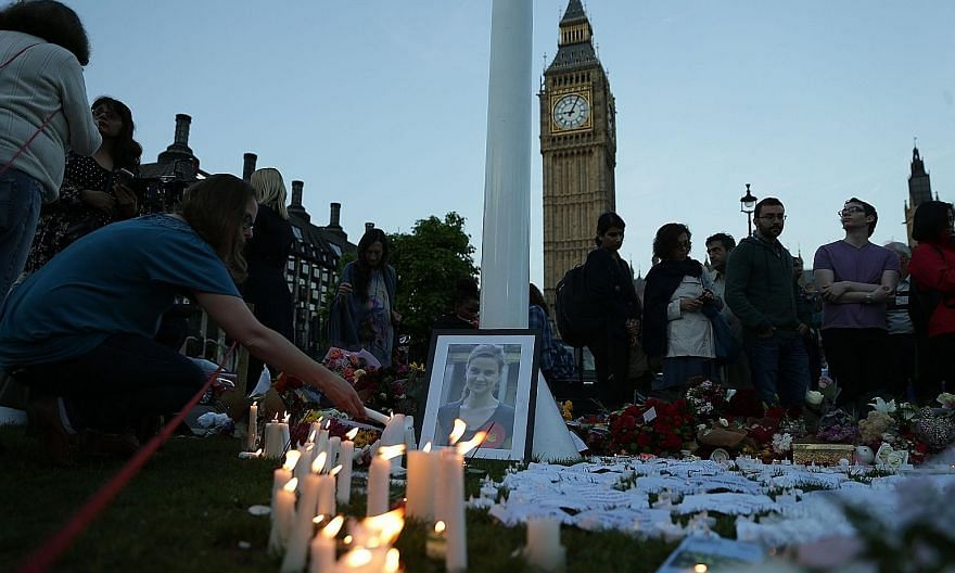 Tributes to slain MP Jo Cox in Parliament Square, London, last Friday. The Labour MP, who was killed in her constituency - Birstall - the day before, had been a fervent supporter of immigration and had campaigned for Britain to remain in the EU. Her