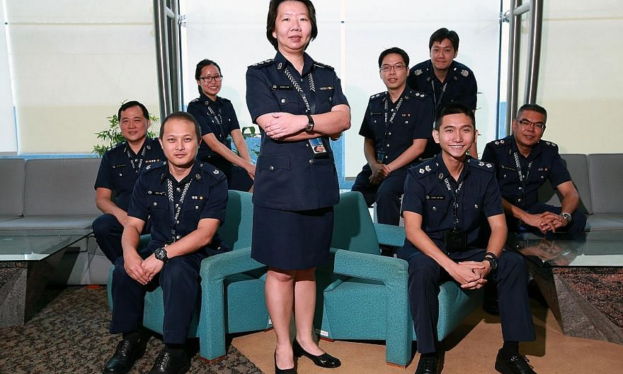 Among those commended at a police ceremony yesterday were Supt Yap (standing), the leader of the team in charge of the Jover Chew case. Members of her team included (from left) Deputy Superintendent Tan Sin Choon, 45; Assistant Superintendent Andy Ta
