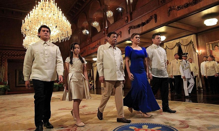 Philippine President Rodrigo Duterte with his children - (from left) Sebastian, Veronica, Sara and Paolo - after the oath-taking ceremony at the Malacanang Palace in Manila yesterday. Veronica, 12, held the Bible of the President's mother, Soledad, w