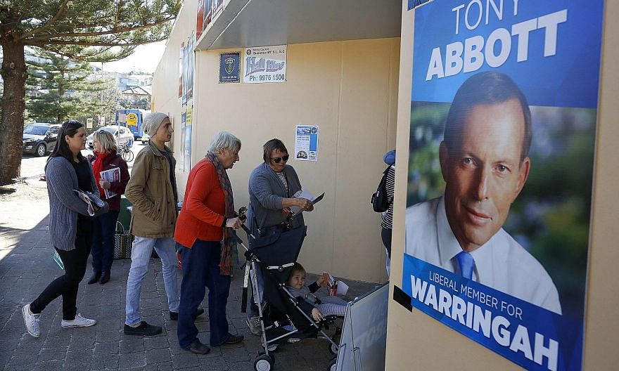 Voters in Mr Tony Abbott's electorate on Polling Day last Saturday. Tensions between Mr Abbott and Prime Minister Malcom Turnbull have been simmering for decades.