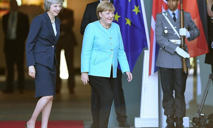 British PM Theresa May (left) with German Chancellor Angela Merkel in Berlin. ST is holding a briefing on Aug 17 in which the outlook and impact of Brexit will be discussed, as well as Britain's economic prospects.
