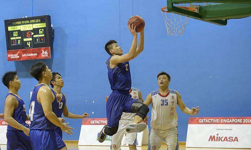 Braddell Heights forward Leon Kwek going up for a basket against Siglap in the Singapore National Games, which conclude tomorrow.