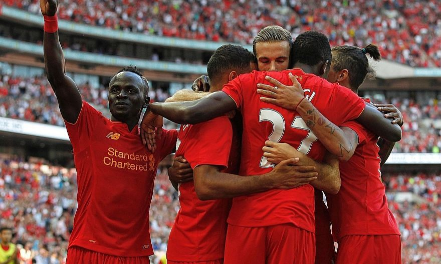 Sadio Mane (left) celebrating with his team-mates during their 4-0 dispatching of Barcelona in a friendly. Liverpool manager Jurgen Klopp will be counting on the Senegalese forward, another recruit from Southampton to provide his forward line with so