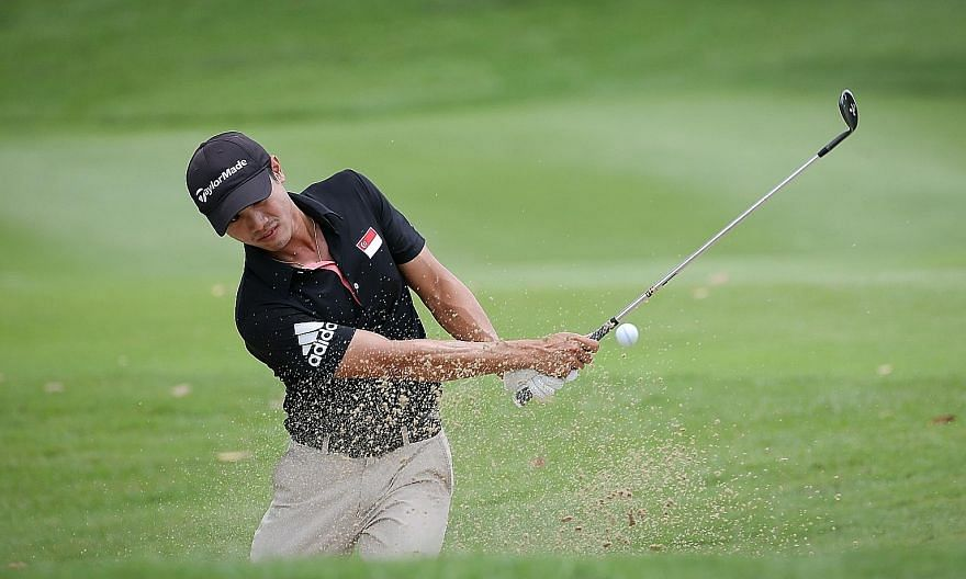 Singapore's Gregory Foo chipping from the greenside bunker to within a foot of Hole No. 12 at the Tanah Merah Country Club's Garden Course. He birdied that par-four hole.