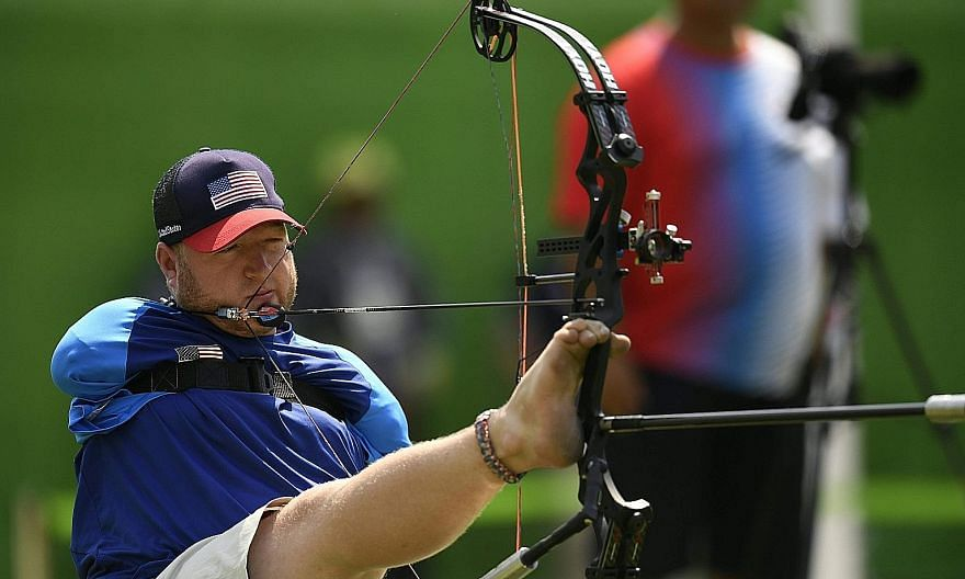 American Matt Stutzman, who has no arms, during the Paralympics archery individual compound qualifying at the Sambodrome. He won silver in London but missed the quarter-finals by a single point in Rio. To shoot, he sits, holding the bow out with his
