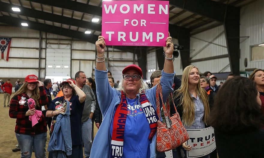 A woman showing her support for Mr Trump before his campaign event in Springfield, Ohio, on Thursday.