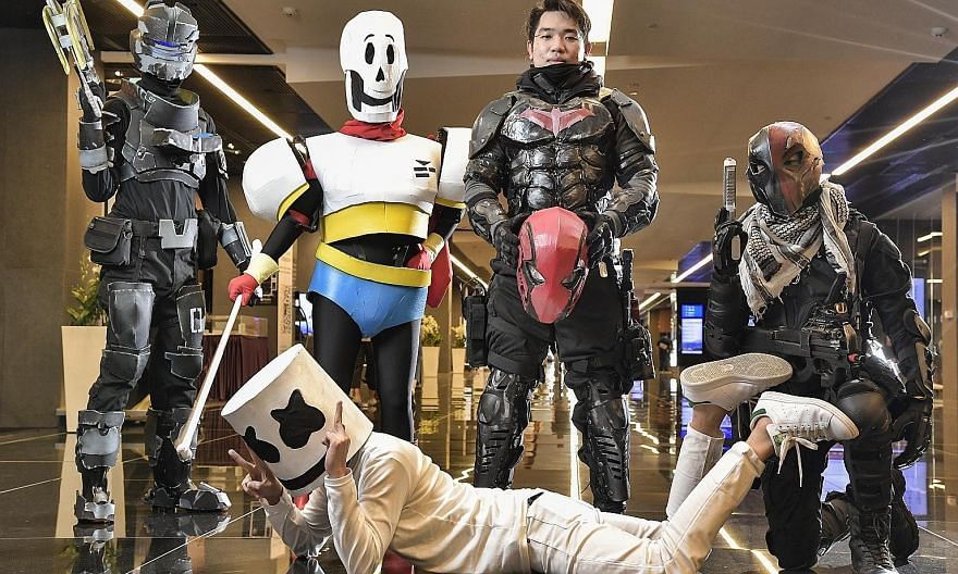 """The cosplayers head home, after having """"transformed"""" back into their usual selves, lugging their costumes and props with them, after attending the GameStart 2016 convention at the Suntec Singapore Convention and Exhibition Centre in October. Mr Yip,"""