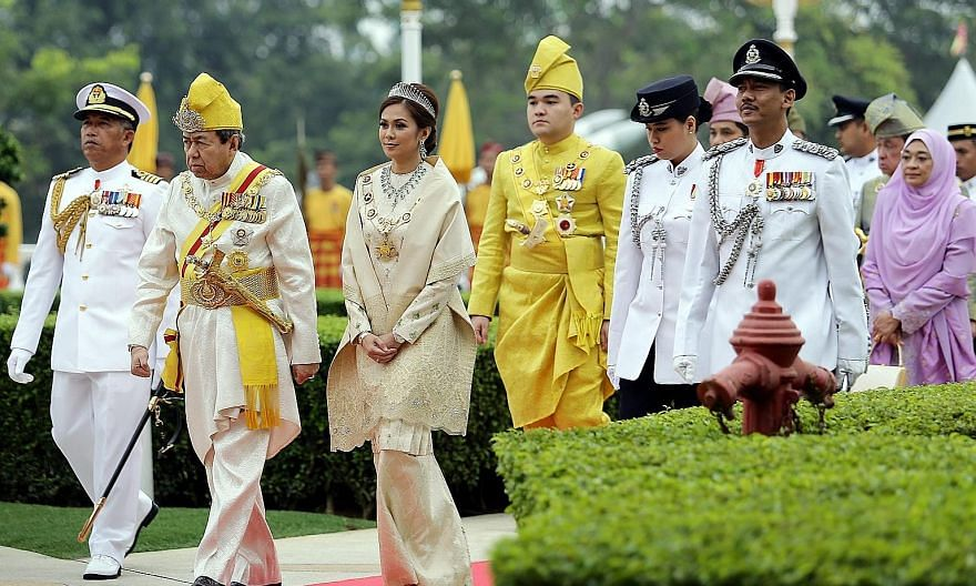 Selangor Sultan Sharafuddin Idris Shah (from second left); his consort, Tengku Permaisuri Norashikin Abdul Rahman; and his son, Tengku Amir Shah, arriving yesterday for an awards ceremony to celebrate the state ruler's 71st birthday at Istana Alam Sh