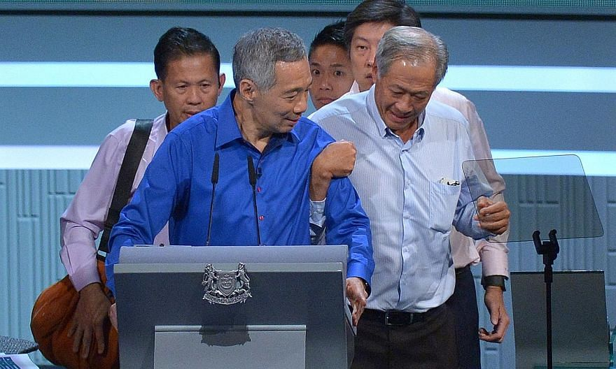 PM Lee (top) being helped by Defence Minister Ng Eng Hen during this year's National Day Rally, with Minister for Education (Schools) Ng Chee Meng and two security officers close behind. Minister Heng (above) being discharged from Tan Tock Seng Hospi