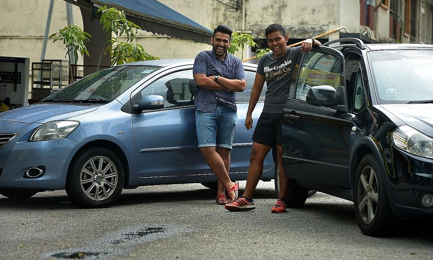 Friends Gurujeet Singh Sanghar (left), 24, and Nur Afiq Jumahat, 23, were drawn to Uber by the potential to earn an income while working flexible hours. Mr Sanghar is now studying full-time but continues to drive during his semester breaks, while Mr