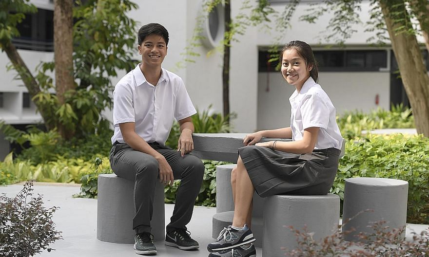 Dominic Koh from Catholic High and Natalie Ng of Singapore Chinese Girls' School, both 16, in the Eunoia Junior College uniform of a white top with a grey pin-striped skirt or trousers.
