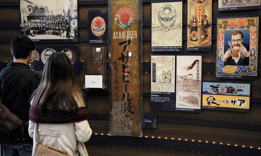 An exhibition of Asahi beer's history at one of its breweries in Osaka. The sale of its Tsingtao stake would help Asahi as it pursues more acquisitions to boost its overseas business, after it agreed last year to buy about US$11 billion of SABMiller