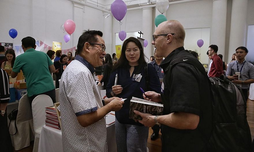 """Care Corner Singapore's Daniel Ong (in white) with Nike representatives Raena Cheong and Jordan Hanauer. Ms Cheong, whose company does not yet have a regular local charity partner, says the speed dating model for networking works """"because Singapore h"""