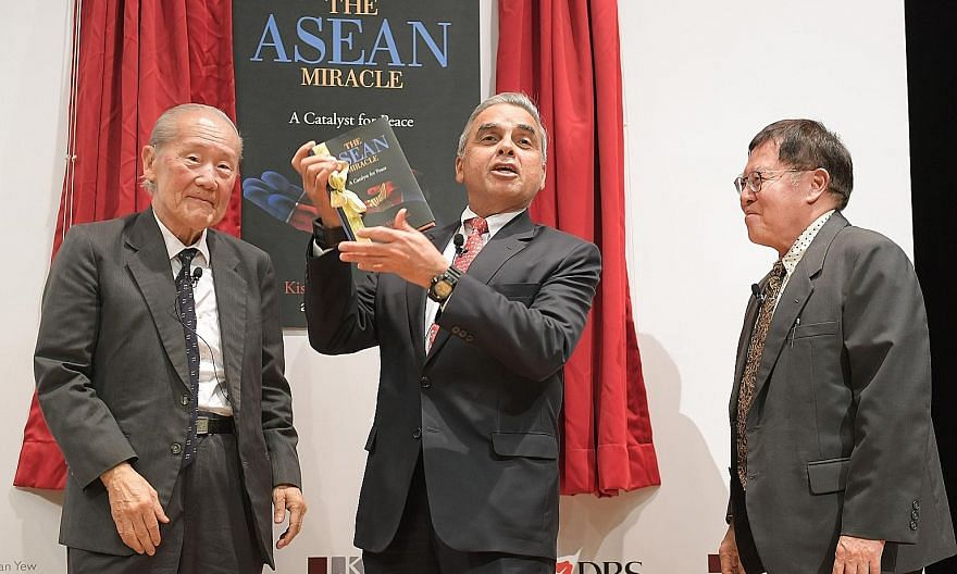 Academics Kishore Mahbubani and Jeffery Sng, with guest of honour Wang Gungwu (far left), at the launch of their book, The Asean Miracle. Over the years, Asean has brought peace and prosperity to the region, with Singapore the biggest winner, says Pr