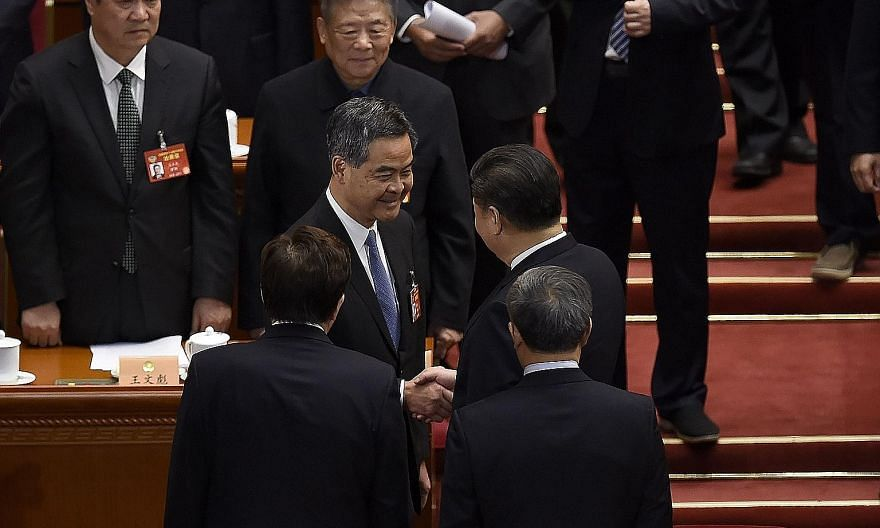 President Xi Jinping (right) congratulating the Hong Kong Chief Executive after he was voted yesterday as vice-chair of the national committee of the Chinese People's Political Consultative Conference.