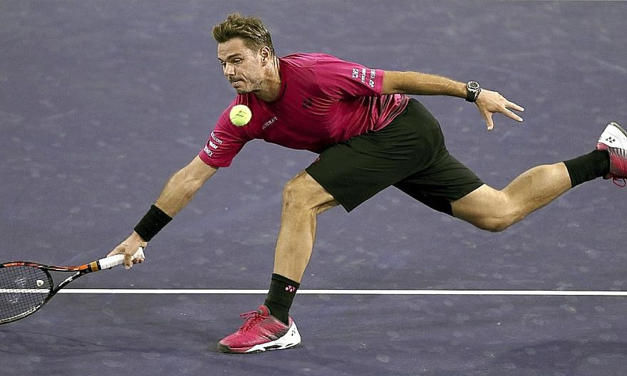 Stan Wawrinka stretching for a return against Austrian Dominic Thiem at Indian Wells, California, during his 6-4, 4-6, 7-6 (7-2) victory. His next opponent is 21st seed Pablo Carreno Busta of Spain.