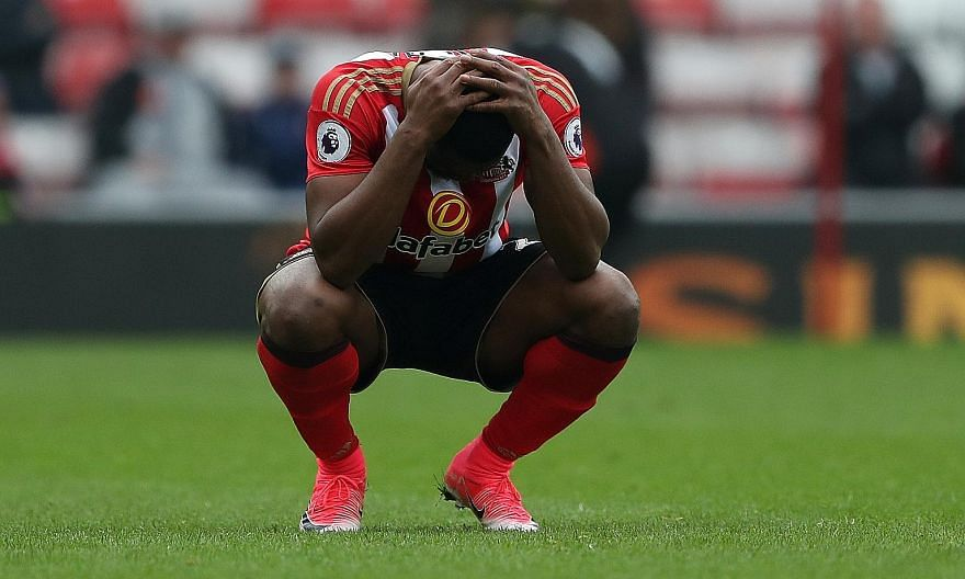 Sunderland's Victor Anichebe can only hold his head in his hands after Bournemouth's Joshua King netted the game's only goal. The Black Cats' 0-1 loss put paid to any faint hopes of beating the drop, condemning them to Championship football next seas