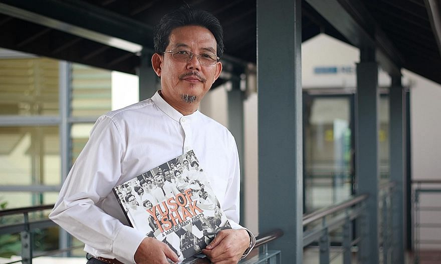 Dr Ooi Kee Beng with his book, Yusof Ishak: A Man Of Many Firsts, which chronicles Mr Ishak's life - from the son of a civil servant to head of state who would steer Singapore through its early years.